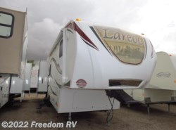 Used 2012  Keystone Laredo 29RK by Keystone from Freedom RV  in Tucson, AZ