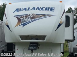 Used 2011  Keystone Avalanche 330RE by Keystone from Mekkelsen RV Sales & Rentals in East Montpelier, VT