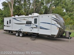 Used 2013  Keystone Outback  310TB by Keystone from Midway RV Center in Grand Rapids, MI