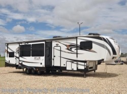 Used 2015  Forest River XLR Thunderbolt Bath & 1/2 Bunk House Toy Hauler by Forest River from Motor Home Specialist in Alvarado, TX