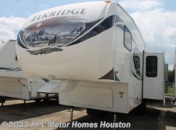 Used 2013  Heartland RV ElkRidge 27RLSS