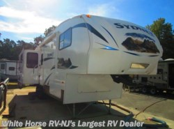 Used 2012  Keystone Outback Sydney Edition 325FRE Quad Slide Rear Entertainment