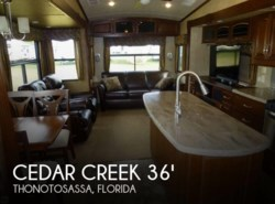 Used 2014  Forest River Cedar Creek 36 CKTS Heritage by Forest River from POP RVs in Sarasota, FL