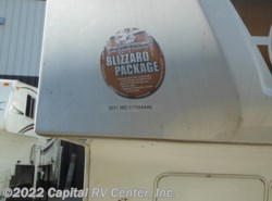 Used 2011  Keystone Fuzion 302 by Keystone from Capital RV Center, Inc. in Bismarck, ND