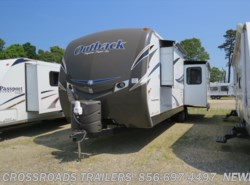 Used 2013  Keystone Outback 298RE by Keystone from Crossroads Trailer Sales, Inc. in Newfield, NJ