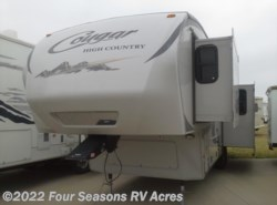 Used 2012  Keystone Cougar High Country 299RKS by Keystone from Four Seasons RV Acres in Abilene, KS