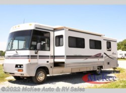 Used 1999  Winnebago  Adventure 34WQ by Winnebago from McKee Auto & RV Sales in Perry, IA