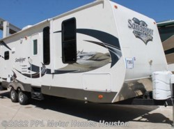 Used 2012  Forest River Sandpiper 29L by Forest River from PPL Motor Homes in Houston, TX