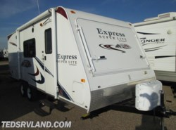 Used 2011  Keystone Passport Ultra Lite Express 235 by Keystone from Ted's RV Land in Paynesville, MN