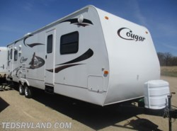 Used 2009  Keystone Cougar 302RLS by Keystone from Ted's RV Land in Paynesville, MN