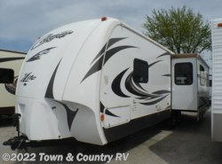 Used 2012  Keystone Cougar XLite 27RLS by Keystone from Town & Country RV in Clyde, OH