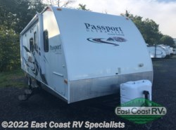 Used 2011  Keystone Passport 2590BH Grand Touring by Keystone from East Coast RV Specialists in Bedford, PA