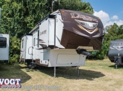 Used 2014  Keystone Laredo 302BH by Keystone from Vogt RV Center in Ft. Worth, TX