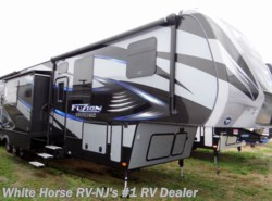 Used 2016 Keystone Fuzion Chrome 414 Triple Slide with 12' Enclosed Garage available in Williamstown, New Jersey