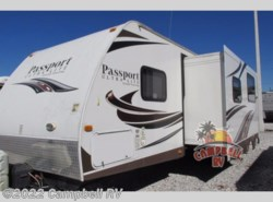 Used 2013  Keystone Passport 2910BH Grand Touring by Keystone from Campbell RV in Sarasota, FL