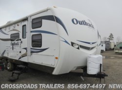 Used 2011  Keystone Outback 301BQ by Keystone from Crossroads Trailer Sales, Inc. in Newfield, NJ