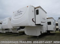 Used 2004  Forest River Cedar Creek Silverback 29LRGBS by Forest River from Crossroads Trailer Sales, Inc. in Newfield, NJ